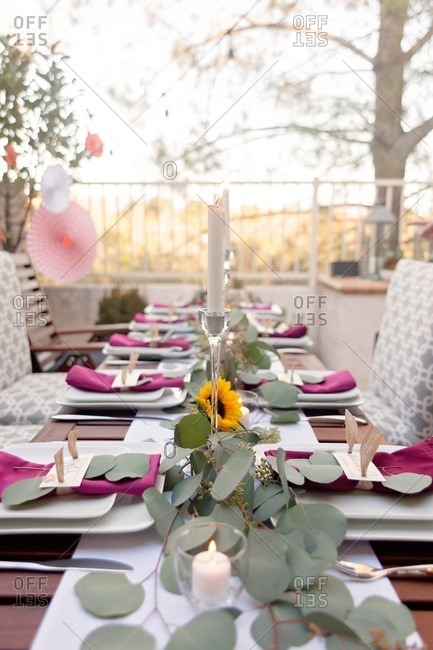Table with candlelight set for an outdoor Thanksgiving dinner party