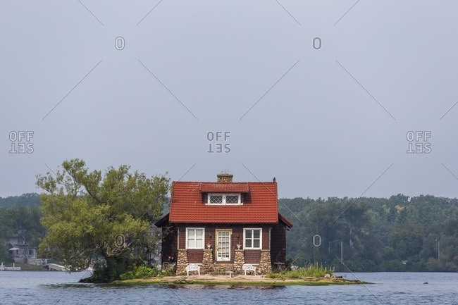 A tiny home sits on a small island in the middle of the St. Lawrence River in upstate New York's 1000 Islands area