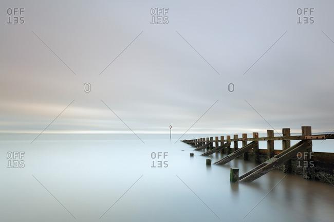 Long exposure of sea Groynes leading into the sea at Portobello beach, Edinburgh.