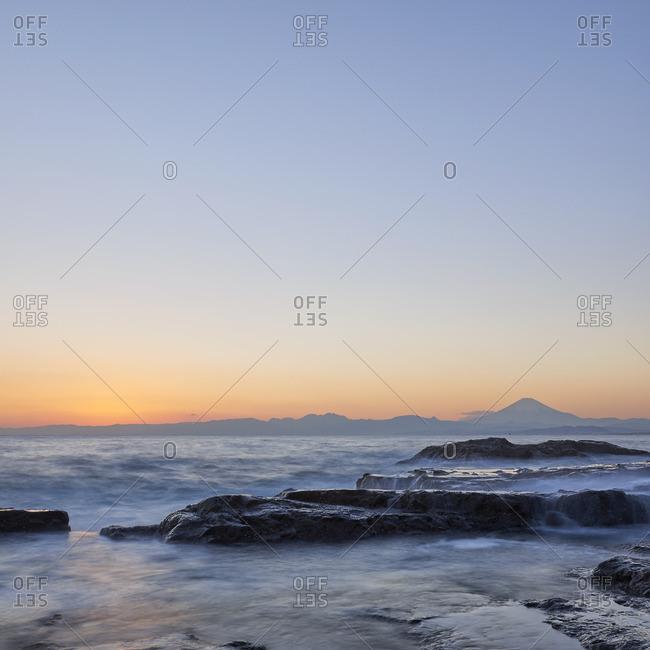 Mount Fuji and silky water after sunset from Enoshima, Kanagawa Prefecture, Japan