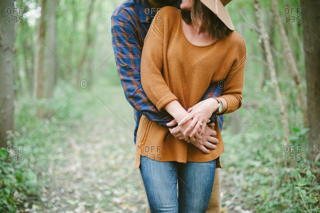 Couple in an embrace on forest trail