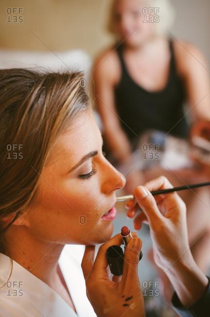 Bride having her lipstick applied