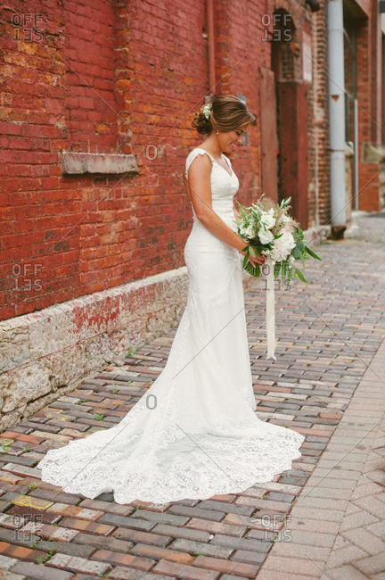 Bride in gown in industrial setting
