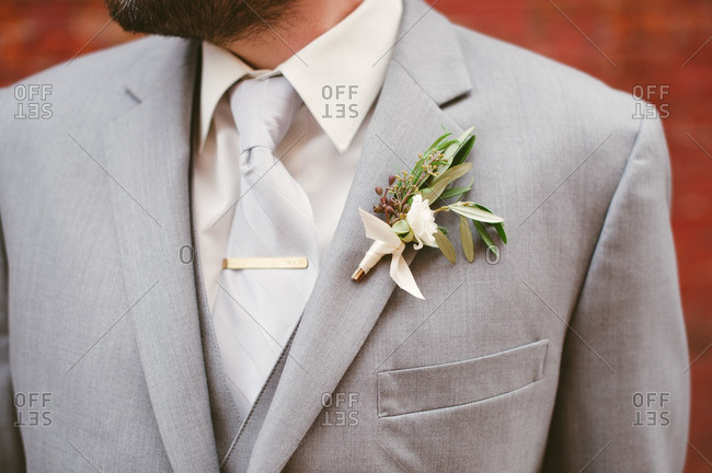 A groom wearing a boutonniere