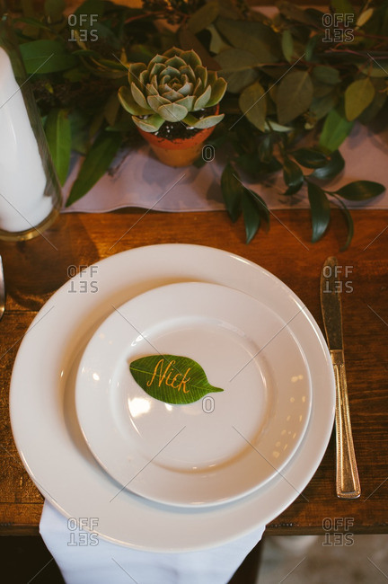 Leaf with groom's name on reception table