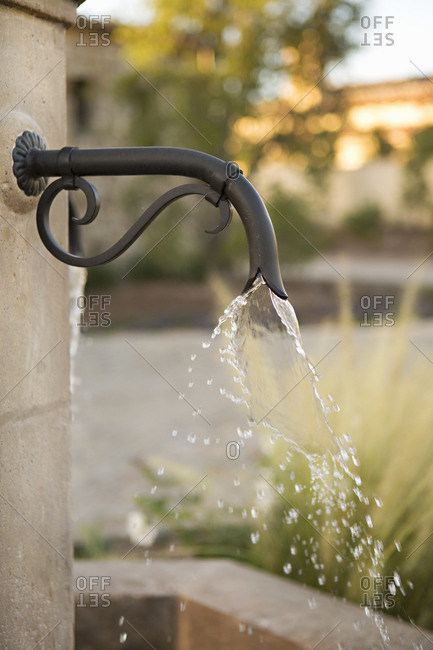 A fountain faucet spraying water