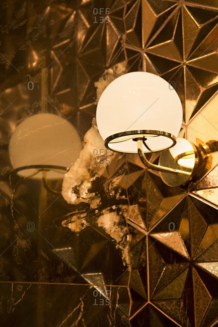 Lamp in corner by worn mirror