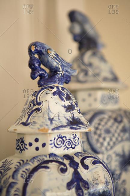 Decorative urn with bird on lid
