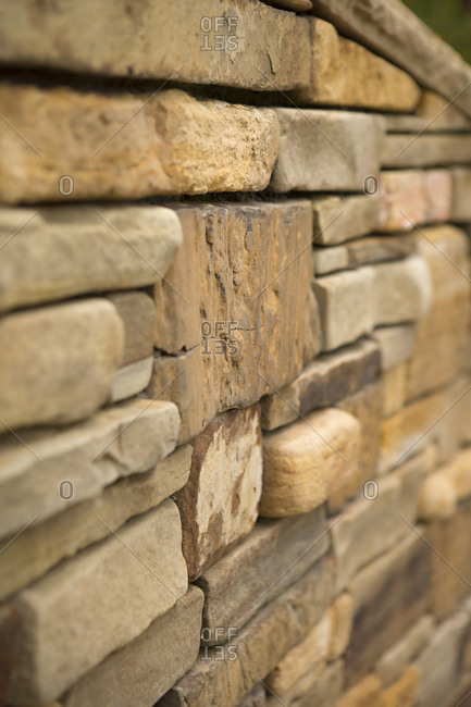 A wall made with stone blocks