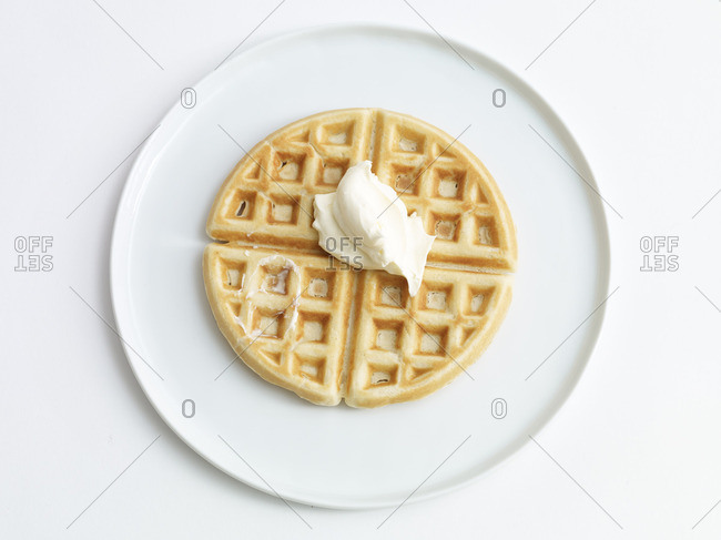 Belgian waffle served with a dollop of butter