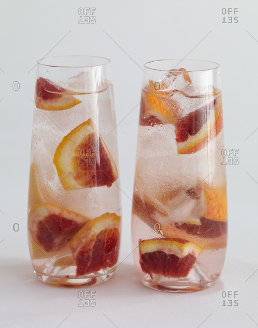 Two glasses of water served with fresh citrus