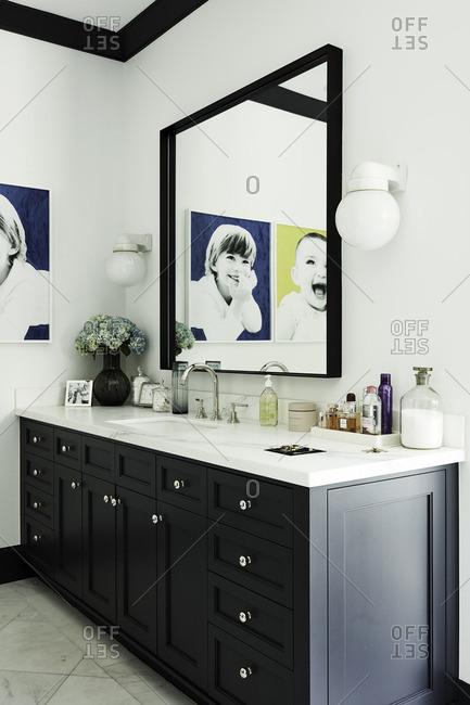 Beverly Hills, California - January 0, 1900: Bathroom mirror reflecting wall art