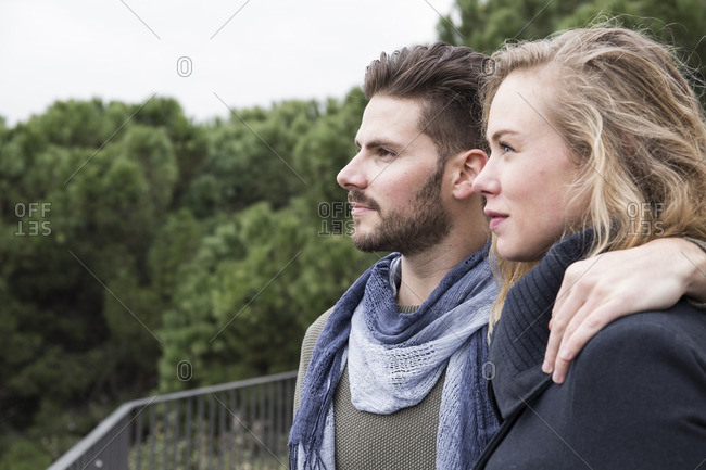 Serious couple looking at view