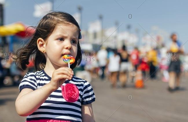 USA- New York- Coney Island- little girl with lollipop
