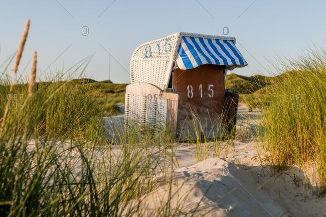 Germany- Amrum- locked hooded beach chair in dunes