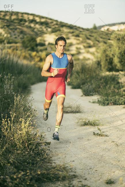 Athlete running in rural landscape