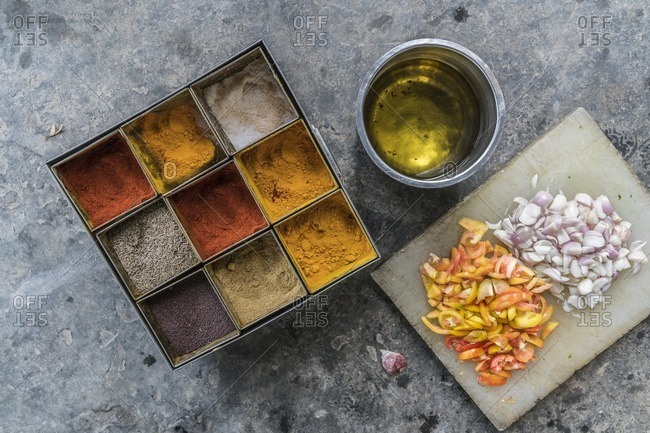 Indian spice box, vegetables and oil