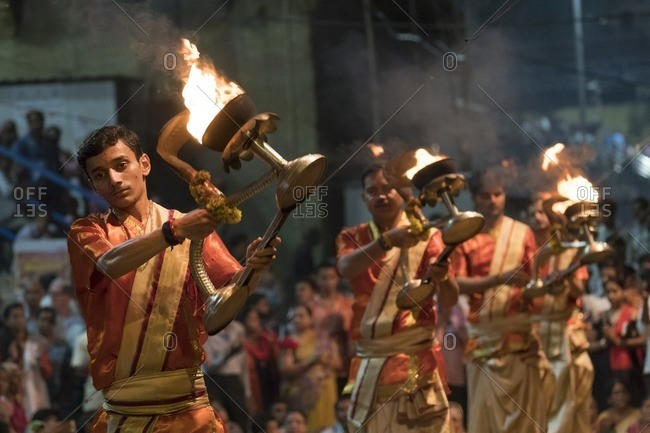Varanasi, India - July 7, 2016:: Men performing ritual with fire during a Hindu Puja ceremony