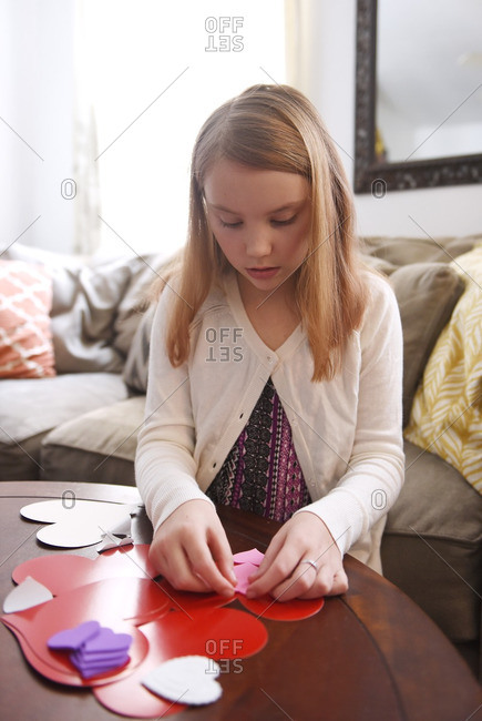 Girl making valentine\'s at table