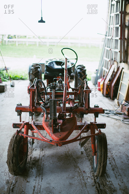 Vintage farm vehicle parked in barn