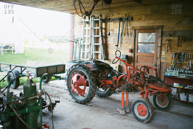 July 13, 2016: Battery powered tractor parked in a barn