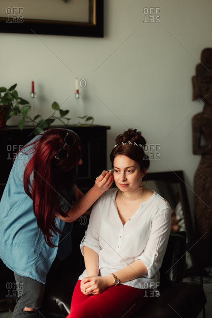 Bride having her eyebrows plucked for her wedding