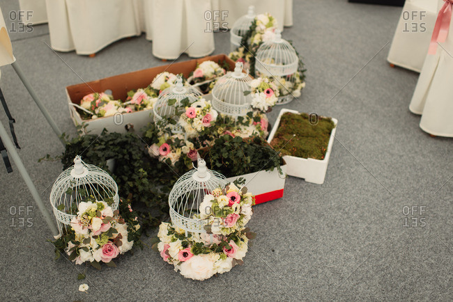 Birdcages decorated with flowers for wedding
