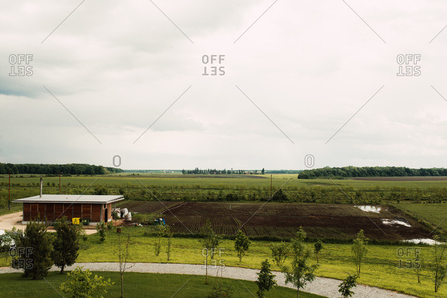 View of countryside with farmland and brown building