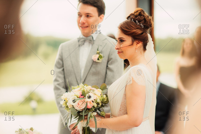 Portrait of a bride and groom during their wedding ceremony