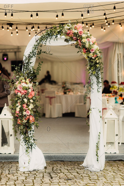 Arbor decorated with flowers at a wedding