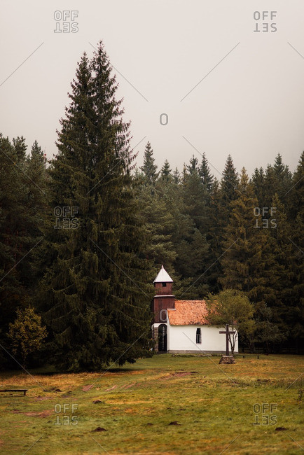 Quaint church on the edge of a forest