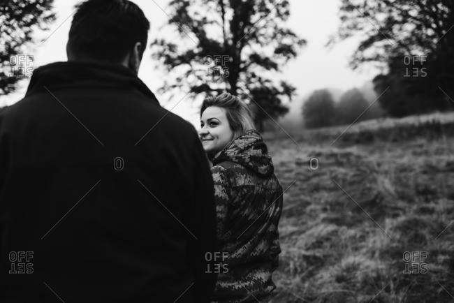 Couple walking outdoors in black and white