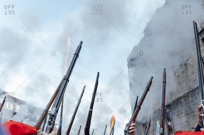 Hondarribia, Spain - September 8, 2014: People firing rifles in Hondarribia Alarde�s parade