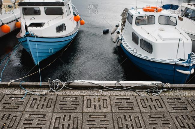 Boats tied to a bulkhead