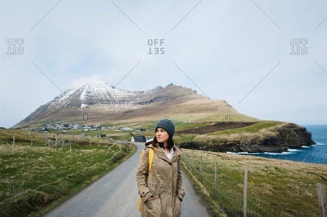 Woman standing on road in the Faroe Islands