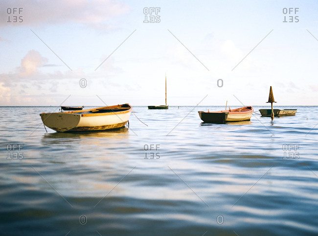 Row boats in calm water at sunrise