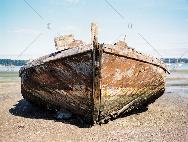 Weathered wooden fishing boat on a beach
