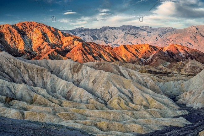 Sun setting over the eroded mountains of Zabriskie Point, Death Valley
