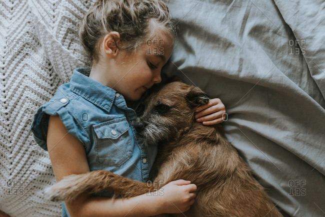 Girl napping with pet dog