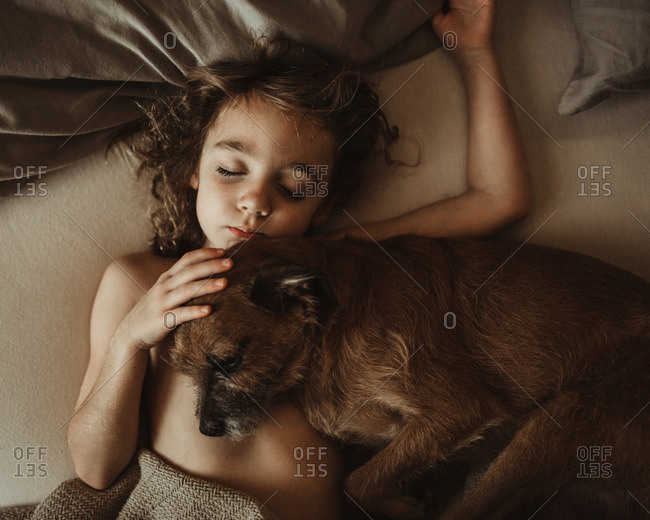 Girl napping with a pet dog