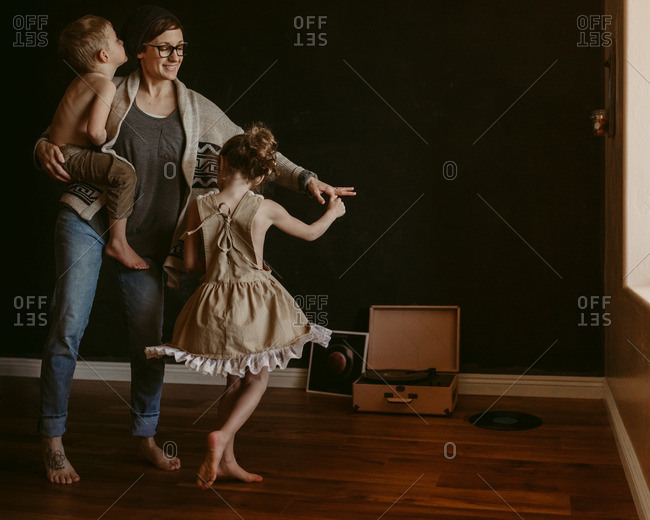 Mom dancing with two kids