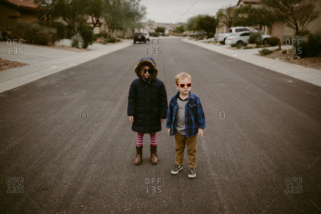 Kids in sunglasses standing in street