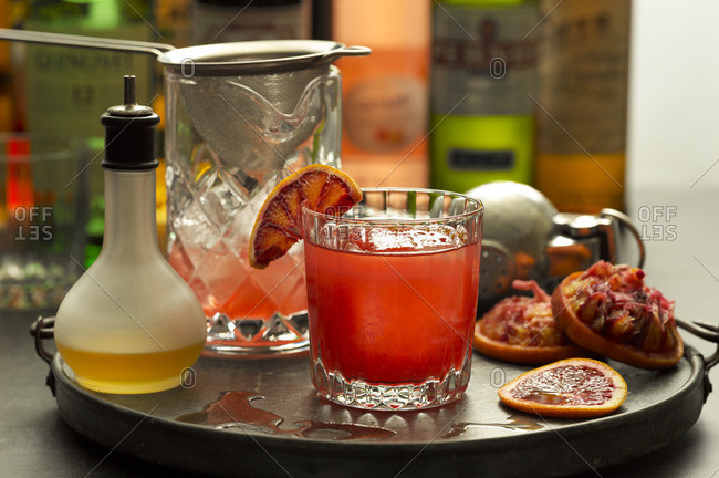 Blood orange & rye cocktail on a serving tray with ingredients
