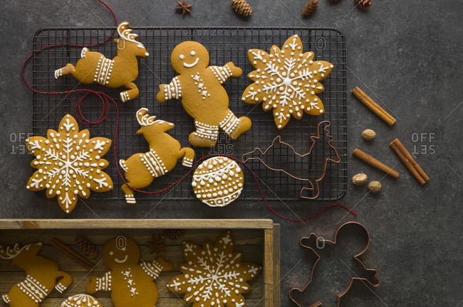 Gingerbread cookies on a cooling rack and in a wooden box