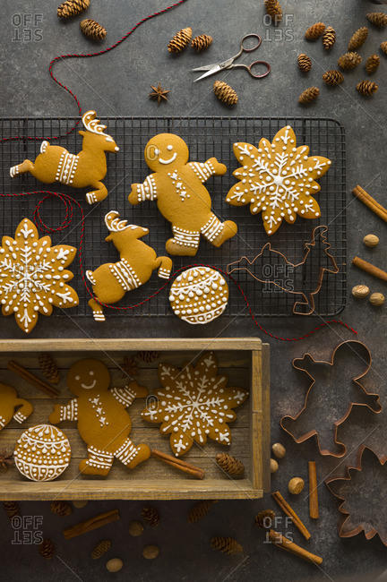 Overhead view of gingerbread cookies on a cooling rack and in a wooden box