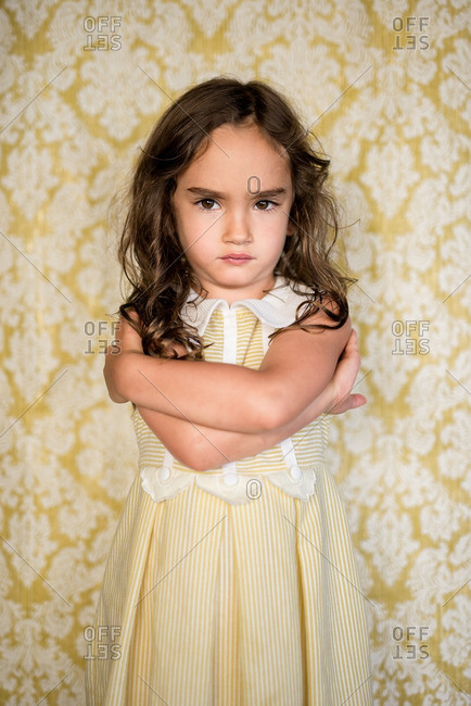 Girl in yellow dress pouting