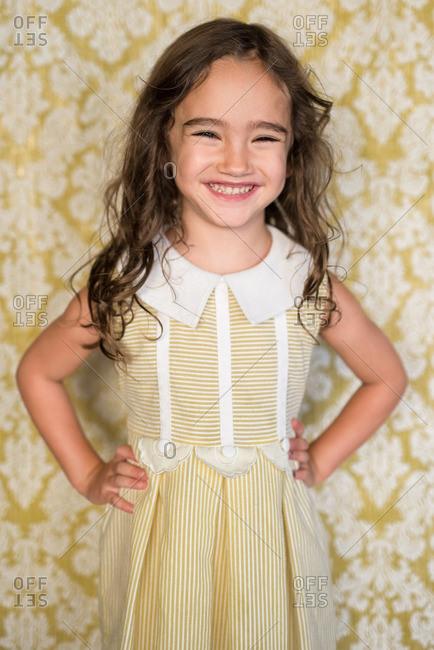 Girl in yellow dress smiling