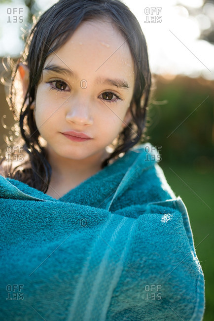 Little girl wrapped in a blue towel