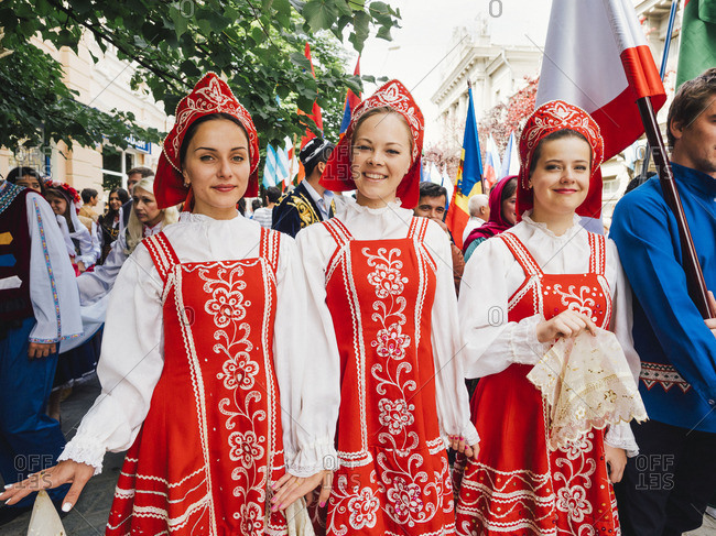 Simferopol, Crimea - January 24, 2017: Girls in red costumes marching in a parade