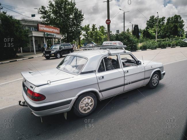 Simferopol, Crimea - January 24, 2017: Taxi driving on the streets of Simferopol